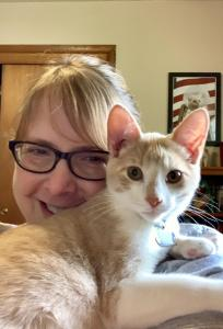 Gouda poses for a selfie with his new human.