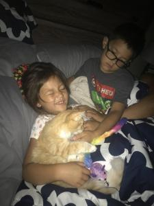 Peyton enjoys some snuggles and fun with her new forever family.